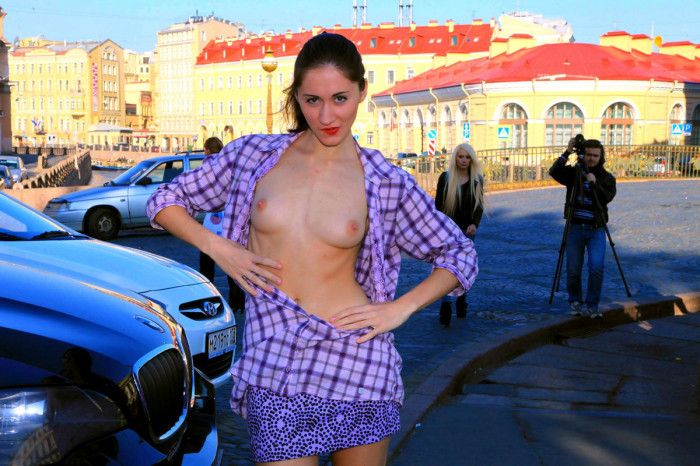 Russian girl opens the robe at a railway station