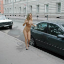 Naked girl with piercings on the streets of St. Petersburg