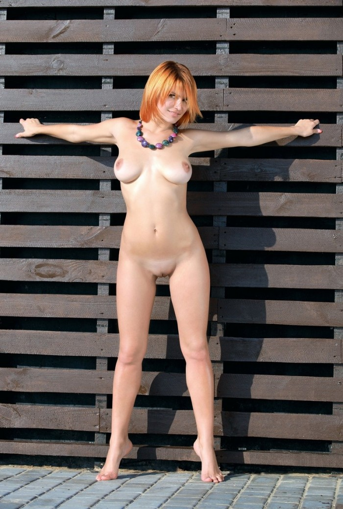 Short haired redhead with amazing natural boobs shows shaved pussy