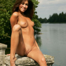 Smiling chick with tanned skin and nice boobs outdoors