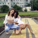 Two lesbians playing with dildo at public places