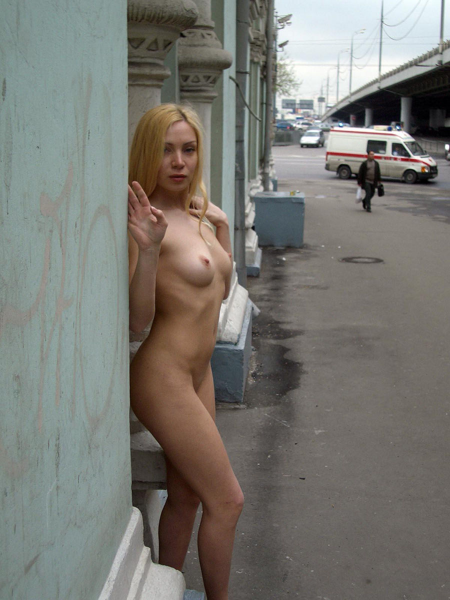 blonde topless in street