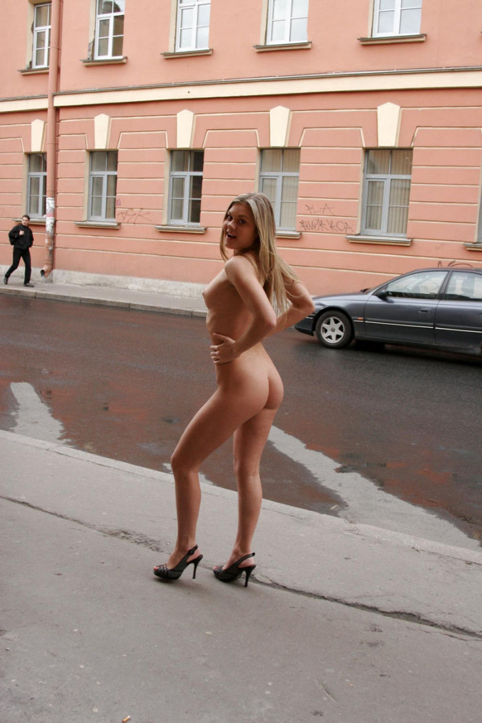 Nude blonde walking along the streets in the early