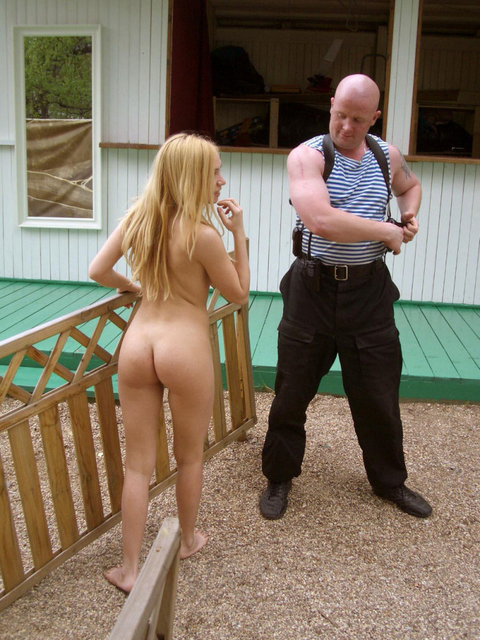 perfect blonde posing with a gun with bodyguard russian