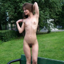 Skinny girl with small tits and big pussy on a park bench