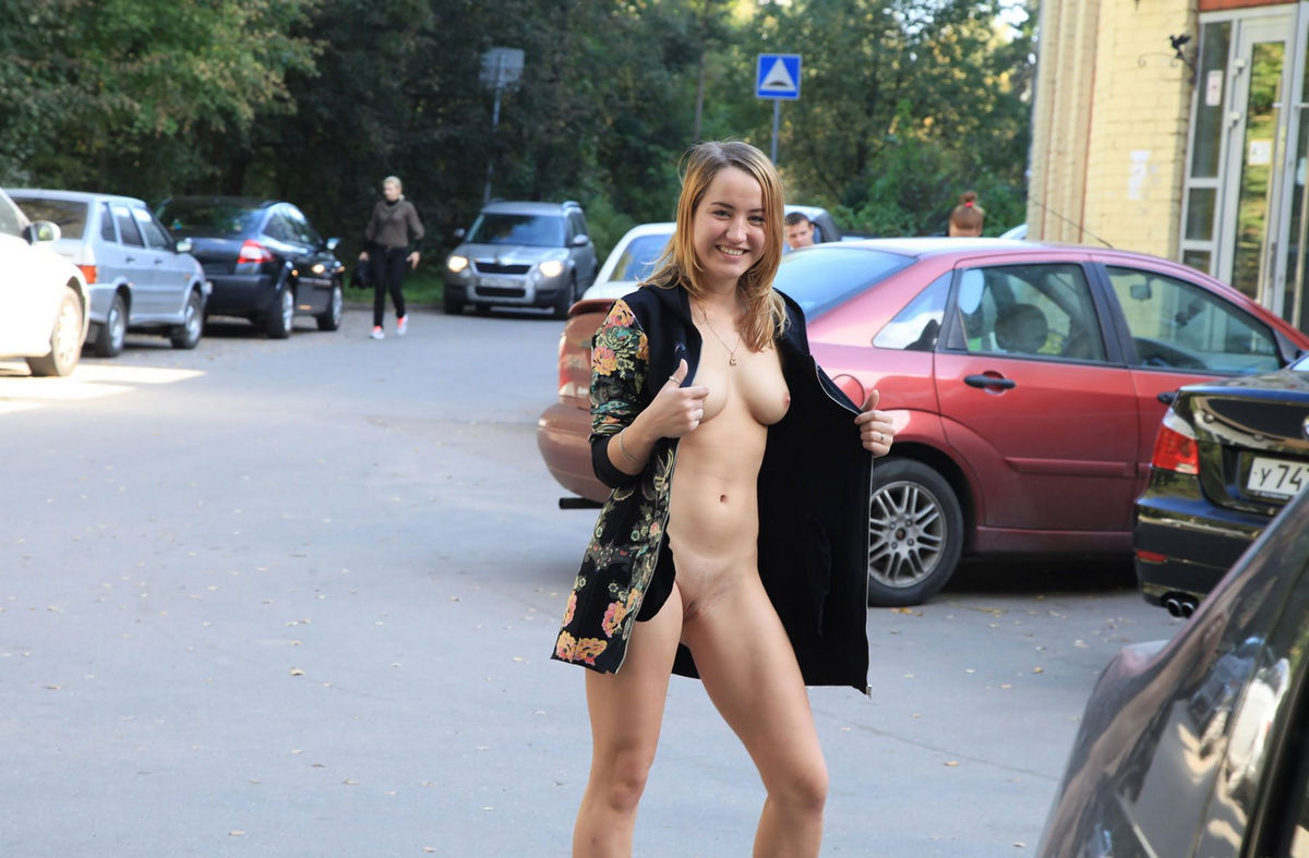 Naked and nude at a bus stop
