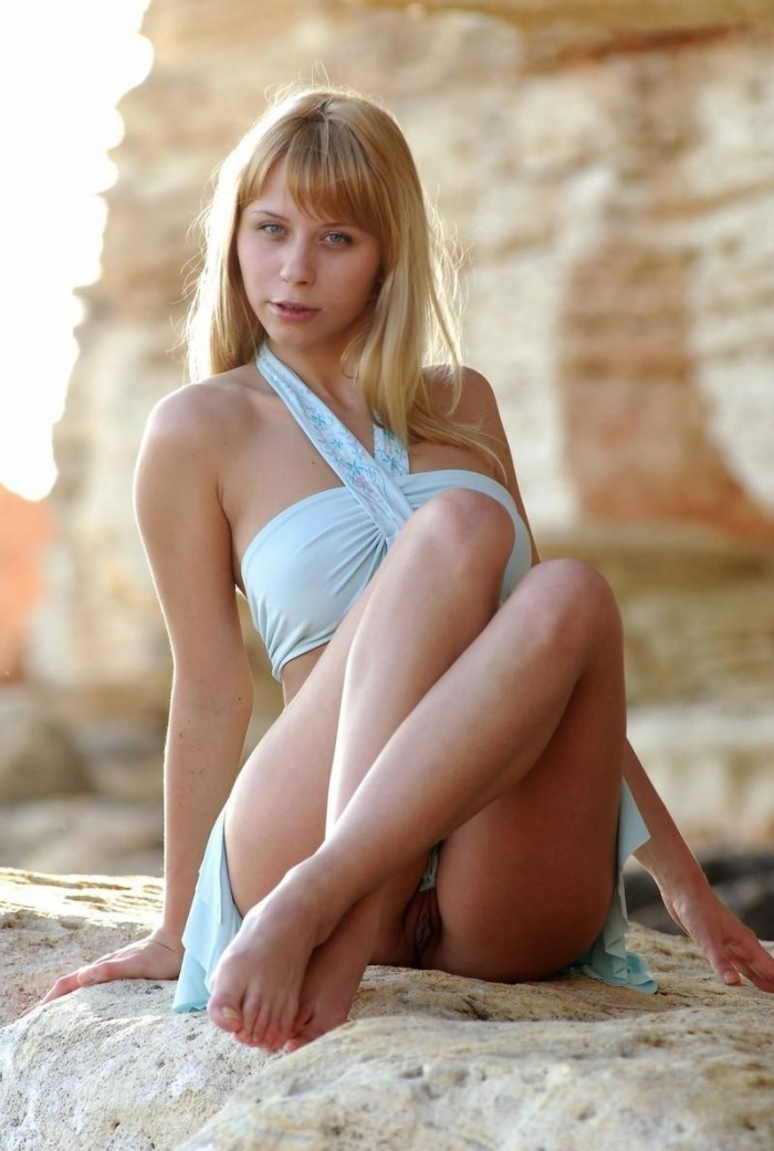 Teen blonde with great boobs and big pussy on the rocks