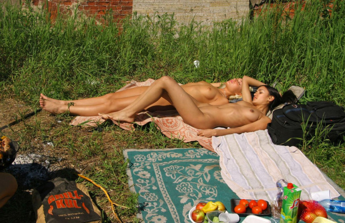 Two young girls have a picnic with no clothes