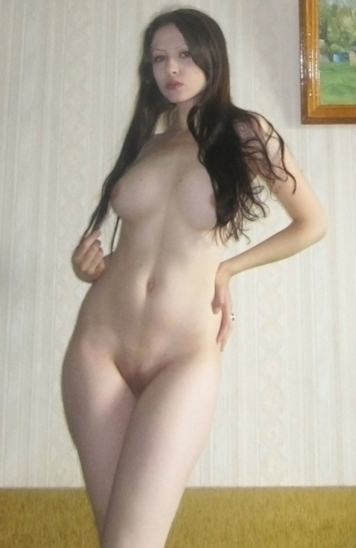 Long haired brunette with huge boobs at home