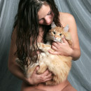 Naked busty brunette playing with red pussy