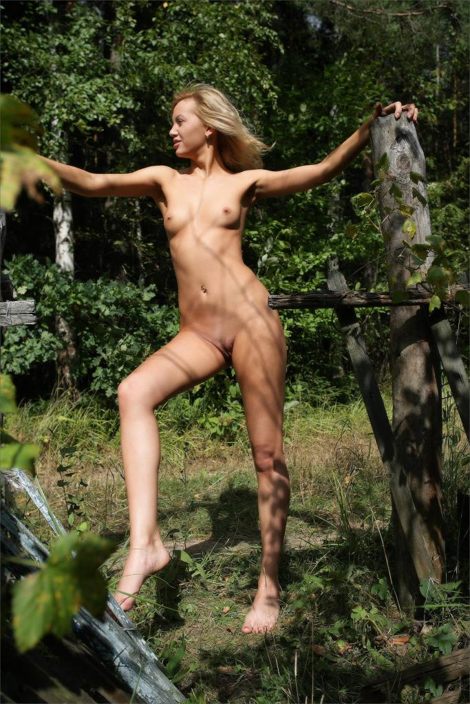 Beautiful slender nude model with legs opened