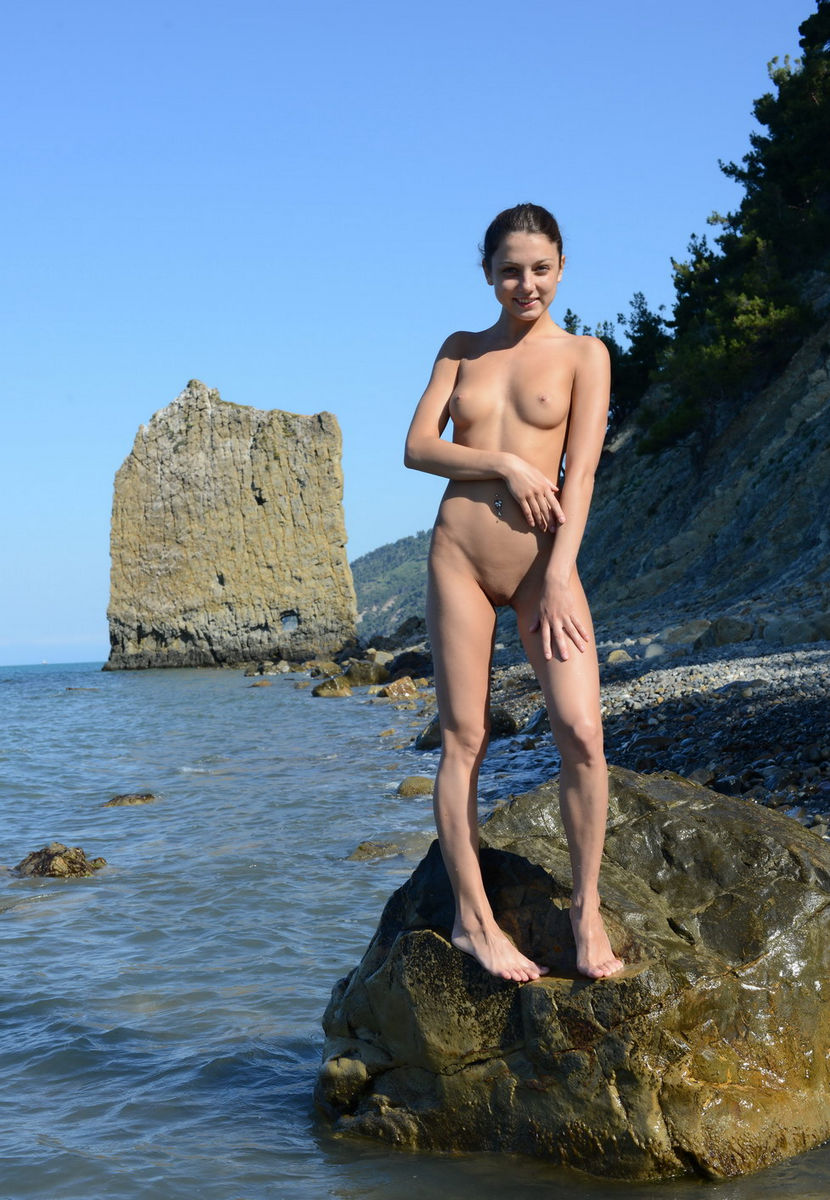 Gina valentina posing nude near the pool