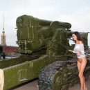 Very hot brunette posing outdoors in war museum