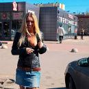 Beautiful smiling blonde with slender body flashing at public