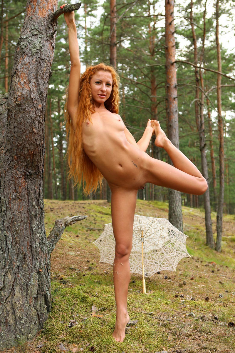 Girl With Long Red Curly Hair Posing In The Forest With -5967