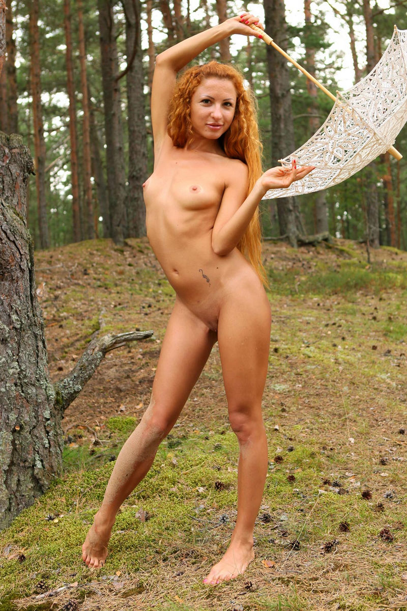 Girl With Long Red Curly Hair Posing In The Forest With -2918