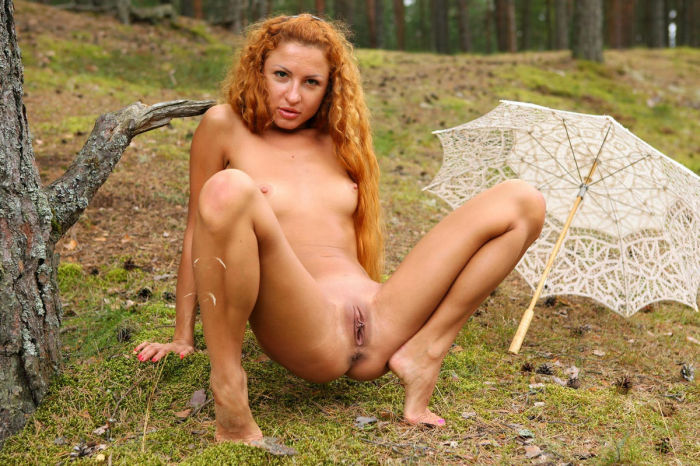 Girl With Long Red Curly Hair Posing In The Forest With -7019