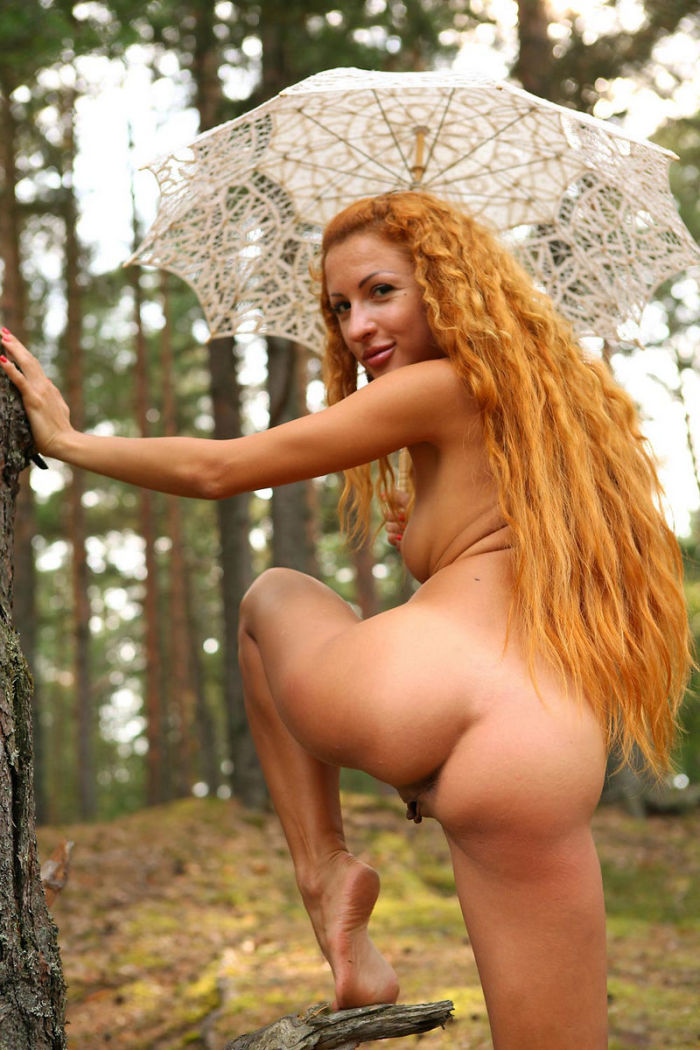 Girl With Long Red Curly Hair Posing In The Forest With -3632
