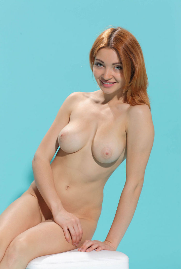 Smiling Busty Redhead Removes Panties In Blue Studio -1778