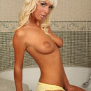 Tanned blonde takes a shower