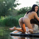 Gorgeous brunette posing on a water bike