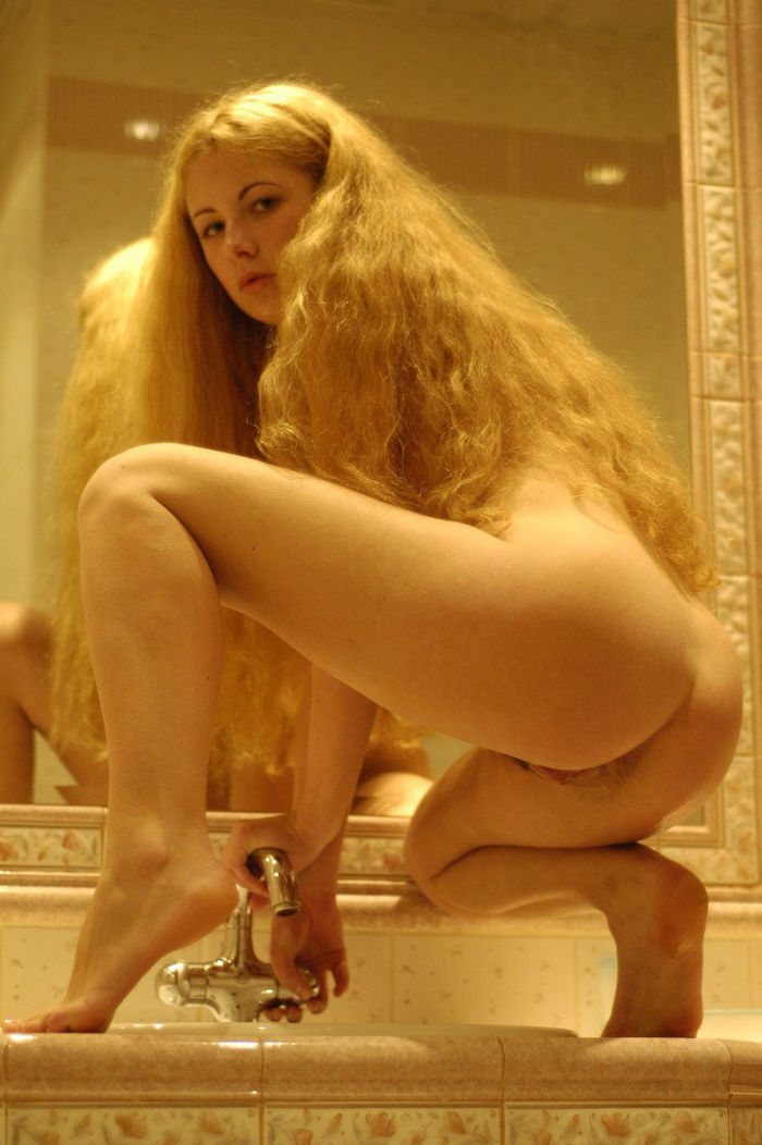Attractive red-haired girl with big pussy by mirror