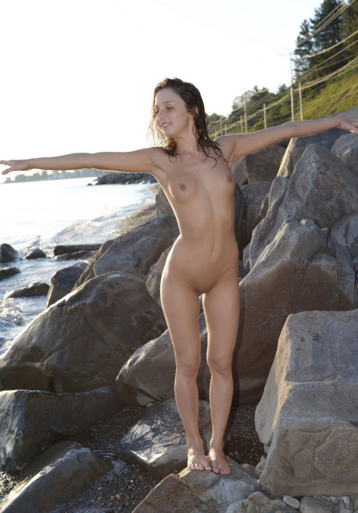 Slim cutie with no clothes on top of the stone