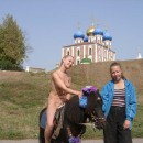 Blonde naked riding a pony near Kremlin