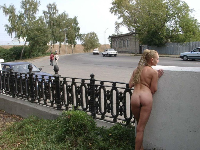 Naked girl and the photographer on the pier of the Moscow River