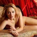 Cute blonde with tasty body on sofa