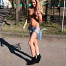 Leggy blonde with snow-white smile in short shorts on the streets