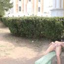 Slender blonde with dreadlocks posing in Ryazan Kremlin