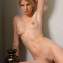 Russian girl with lovely face with amphora in white room