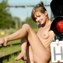 Skinny leggy blonde with railway traffic lights