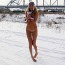 Blonde Varvara with gorgeous boobs walks naked at winter