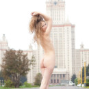 Blonde takes off white skirt in front of Moscow State University