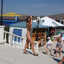 Shameless naked girl on the market in the resort town
