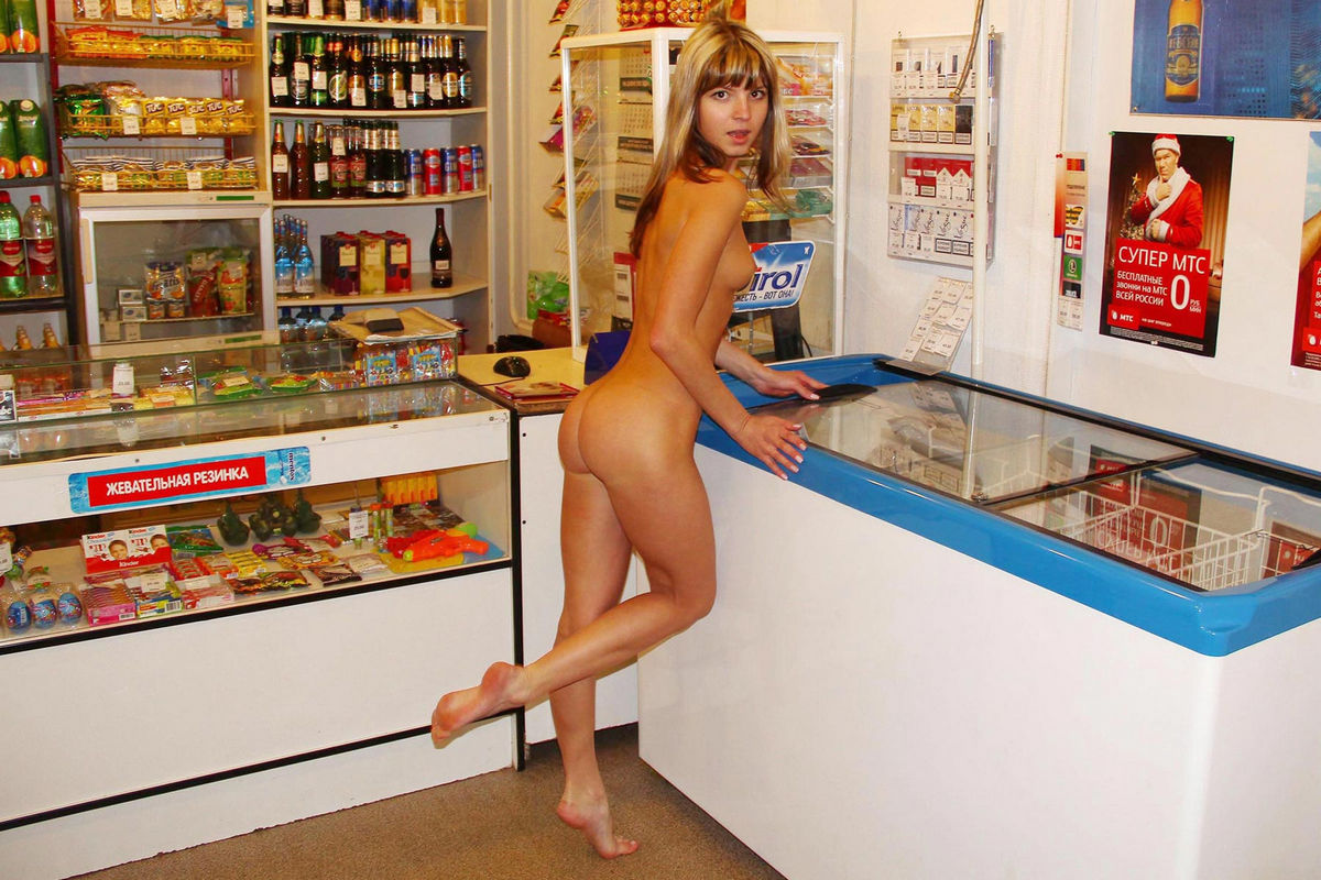 Nude woman in adult store right!