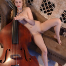 Young curly blonde Angelika D with bass