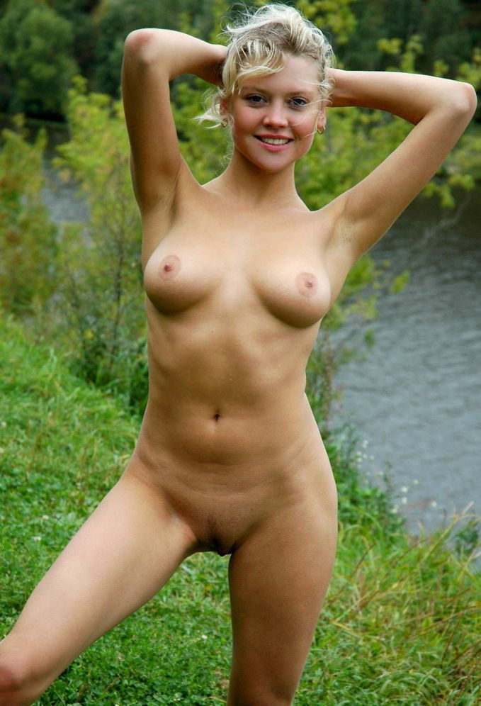 Teen with soft boobs posing naked at public streets
