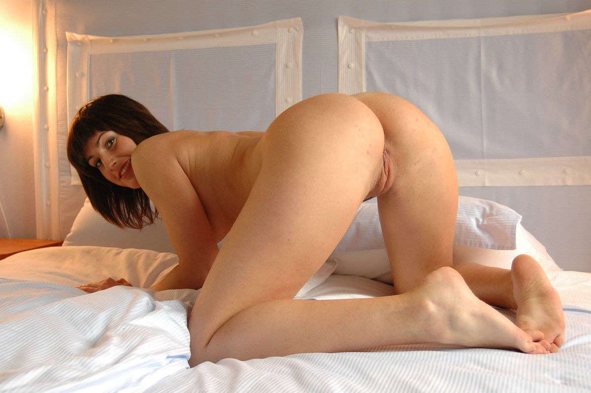 haired russian girl with round ass on white bed russian sexy girls