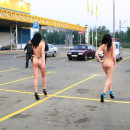 Two amateur brunettes posing naked on shopping mall parking