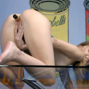Blonde Sveta plays with small dildo on glass table