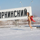 Brunette from Chelyabinsk posing at shovel monument