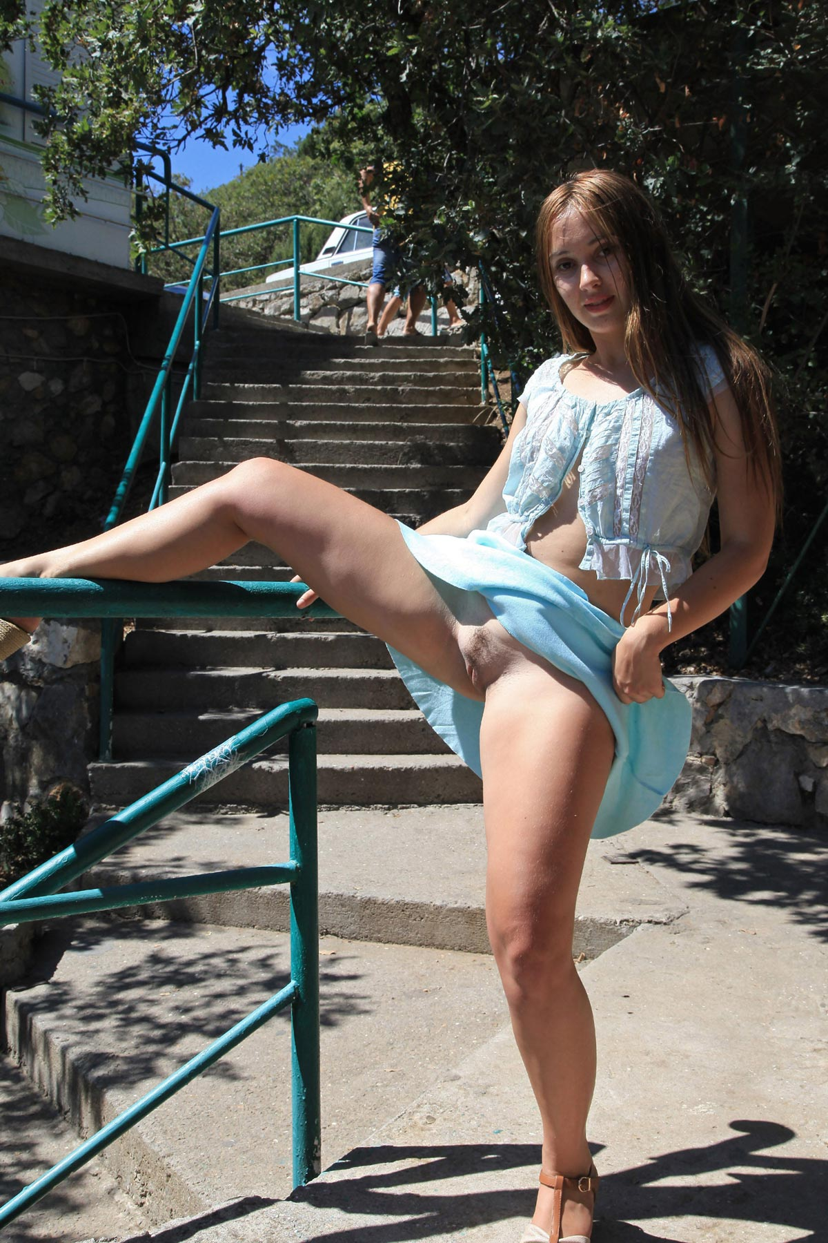 Busty teen in blue skirt flashes her pussy at public ...