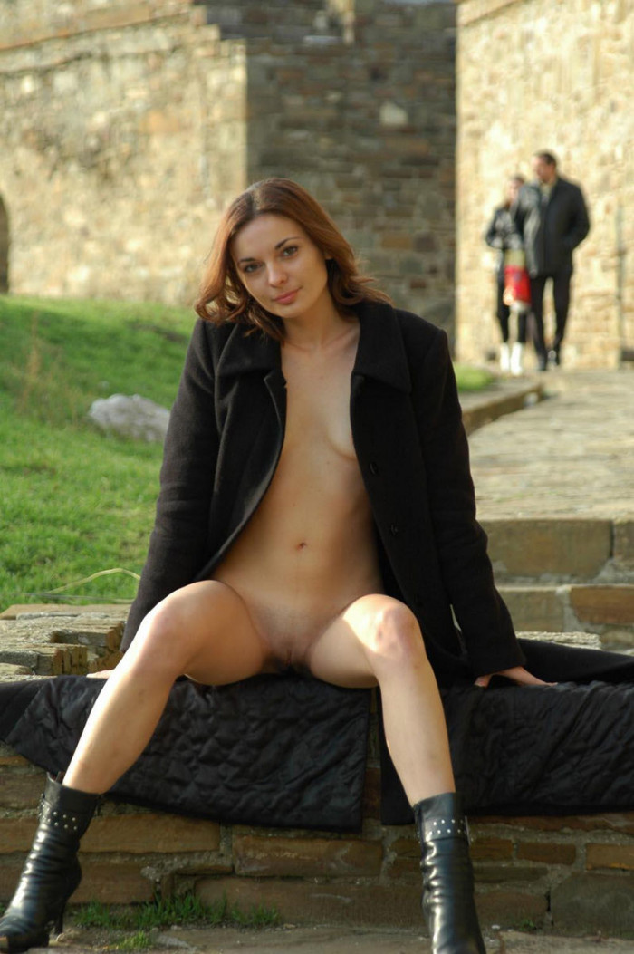 Slim girl in frosty day in front of a group of men