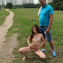 Tiny Juliette D posing at public place outdoors