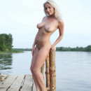Blonde Isabella D with soft boobs on the pier