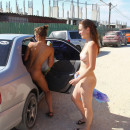Two shameless girls undress in resort town in Cremea