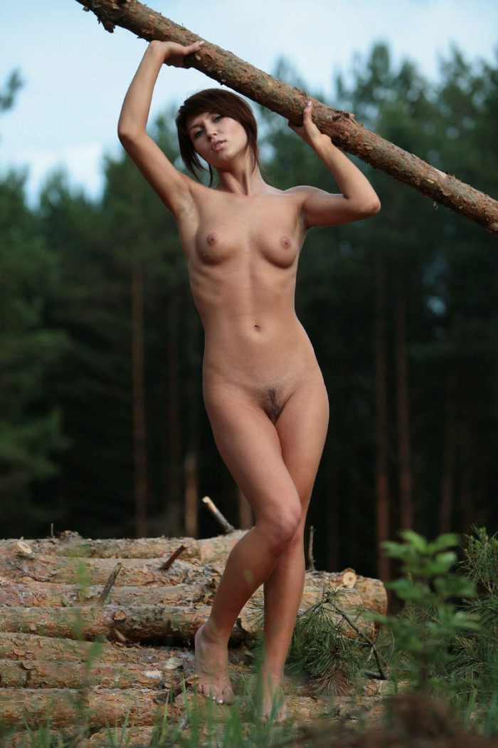 Big russian brunette posing outdoors